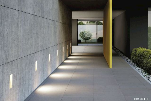 """The Ghost line represents a revolution in the way of conceiving outdoor lighting.It works by """"subtraction"""" rather than """"addition"""": no visible lighting fixture is added to the building's structure, but on the contrary it consists in a void filled with light.The light comes directly from the structure and emphasizes the creative path envisaged by the lighting designer. Ghost is a sign, a bright pixel that appears or disappears marking the architectural rhythm.It is a primary element, similar to a brick. With a brick youcan build a small wall but also a cathedral."""